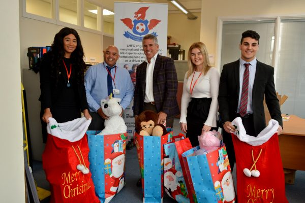 SPG Law team donating to our Christmas Toy Appeal